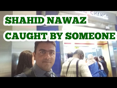 SHAHID NAWAZ CAUGHT BY SOMEONE ON THE WAY OUTSIDE THE RTA BUS !!!
