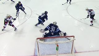 Pavelec gets paddle down, keeps puck out of net