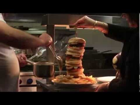 Britain s tallest burger  is 16 inches high and has two POUNDS of meat   Watch the video   Yahoo Ya