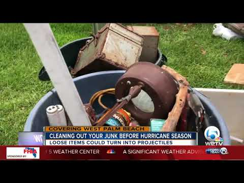 Cleaning up debris from yard in preparation to hurricane season