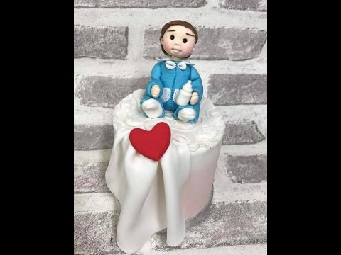 Baby boy figurine modelling