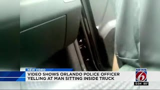 Video shows Orlando police officer yelling at man sitting inside truck