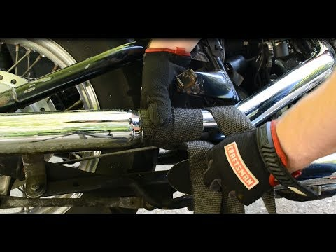 Heat wrapping motorcycle exhaust pipes