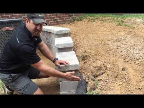 Installation of a Retaining Wall with a Sock Drain