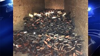 Man arrested after nearly 10,000 stolen guns found in his house