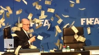 Sepp Blatter was showered with dollar bills during a FIFA meeting | Mashable