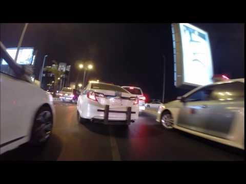 Riding through traffic in Jeddah. Lots of nice cars!