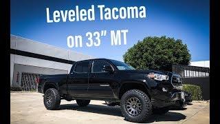 Tacoma with Fox Coilovers Method NV Wheels Camburg UCA