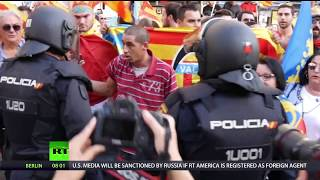 Pain in Spain: Catalan society & politicians split over region