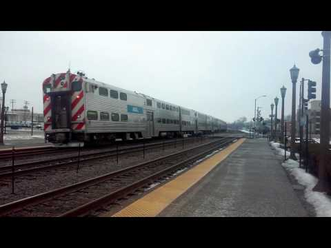 Inbound and outbound Metra trains @ Elmhurst with Wrigley Field Express Pace bus