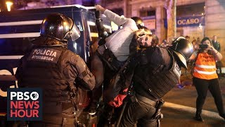 News Wrap: Hundreds charged in Barcelona protests