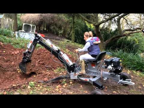 Blonde Women Operating the Jansen MB-300 Mini Excavator
