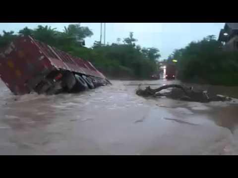 Heavy vehicle sink in rain water