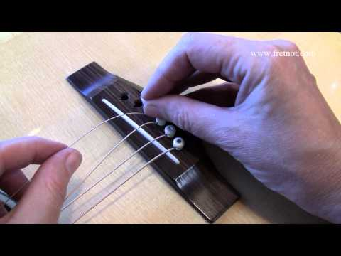 Changing Guitar Strings - What Causes Flying Bridge Pins ?