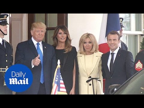 Trumps welcome the Macrons to the White House with French kisses - Daily Mail