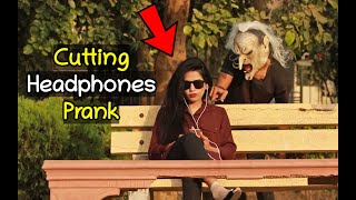 Scary Mask Man Cutting People Headphones Prank - Pranks in Pakistan - LahoriFied