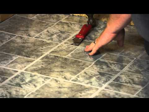 How to Remove Tile on Top of a Wood Floor : Flooring Maintenance