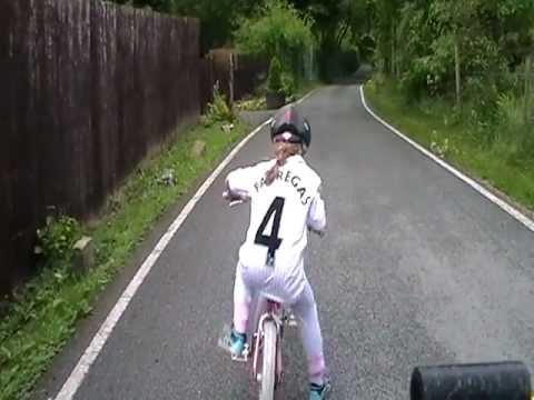 little girl falling of her bike