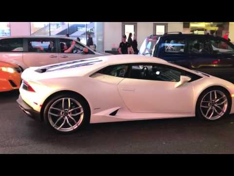 Bike jumps over the hood of a Lamborghini in Times Square