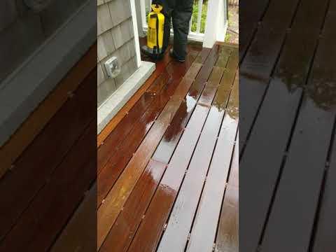 Applying brightener to Ipe deck.