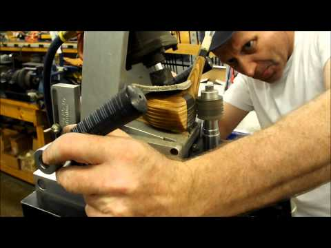 Scoring grooves into wooden golf clubs at Bob Burns Golf