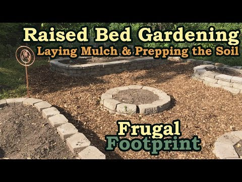 Raised Bed Gardening - Laying Mulch & Prepping the Soil