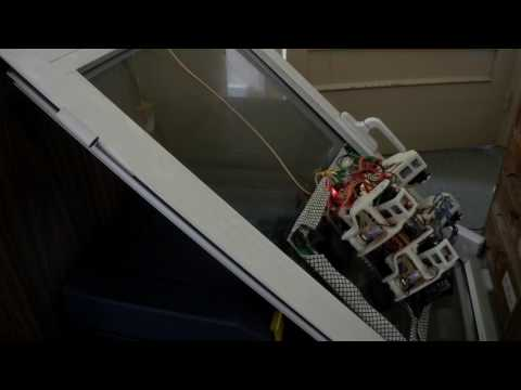 Passive suction cups window cleaning climbing robot - tilted window