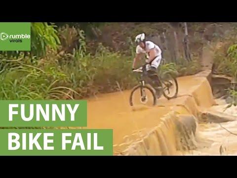 Epic fail: Guy on bike falls into river
