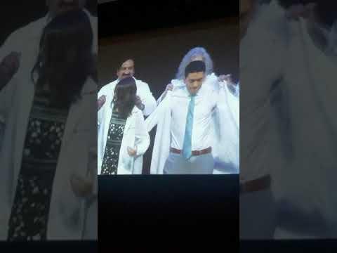 Chris getting his white coat for NYU dental school 2018