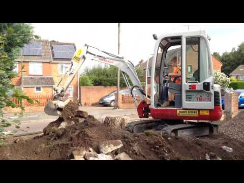 8 Year Old Boy Operating A Takeuchi Mini Excavator / Digger