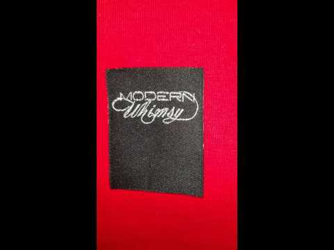 Woven clothing label with Sateen vs Metallic thread