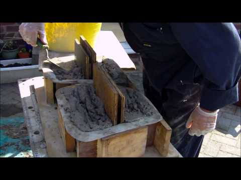 Making concrete retaining wall blocks using Mold Creations Moulds.