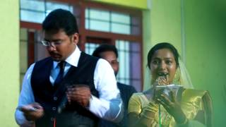 BRIDE & GROOM SINGING   KERALA WEDDING FUNCTION   Malayalam Song   Poonkattinodum   Singing Couple