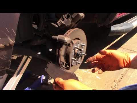 Kia Sportage front brake pad replacement.