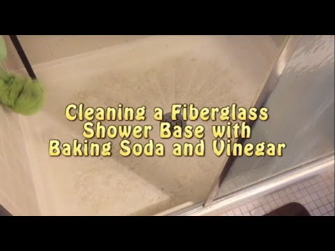 Cleaning shower base with baking soda and vinegar