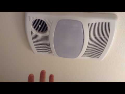 NuTone 100cfm ceiling directionally adjustable exhaust bath fan with light and 1500 watt heater rev