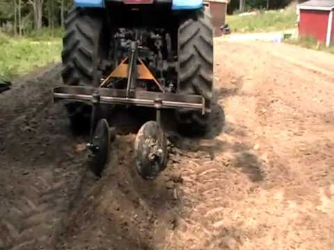 Part 1 - Home made tractor attachment hiller row bed maker planting potatoes