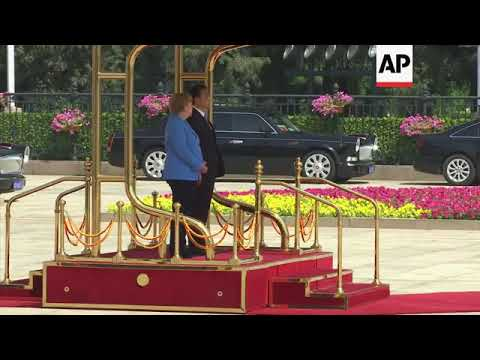 German Chancellor Angela Merkel welcomed to China by Premier Li