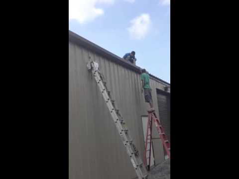 Installing gutters on a metal building