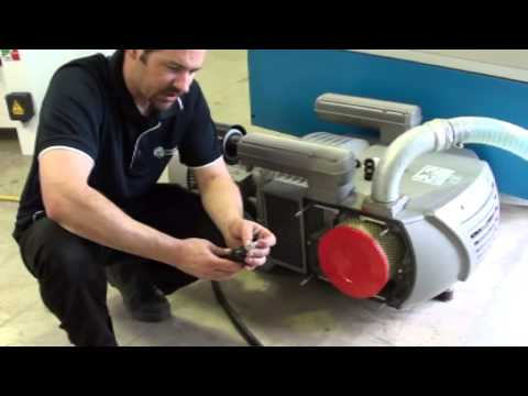 Cleaning the vacuum pump on a CNC machine