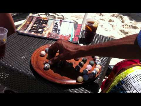 Marble Solitaire game, solution by David. The Champion from Sugar Beach, La Pirogue.  Mauritius