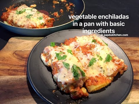 vegetarian enchiladas in a pan with basic ingredients | vegetable enchiladas (mexican cuisine)