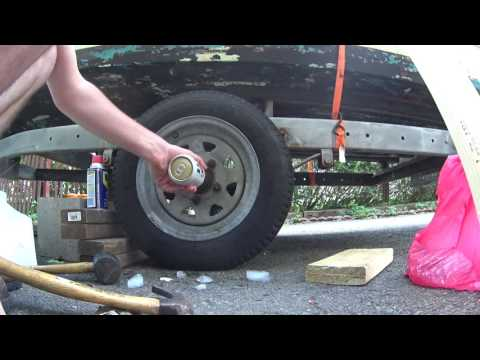 Remove Old Bearing Buddy Using Ice And Cold Beer - Boat Trailer Repair