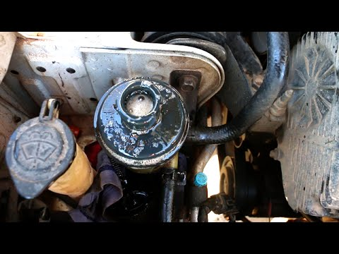 Power steering fluid foaming, overflowing. Pump makes Grinding Sound - Fix Cracked Hose on Pump