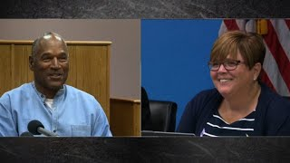 See O.J. Simpson laugh with parole commissioner