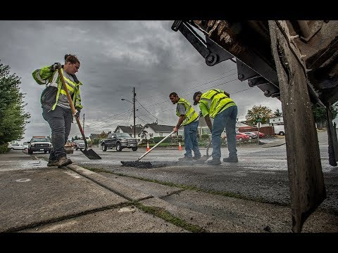 Satisfying look at city crews filling in potholes