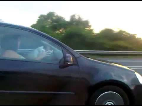 Crazy Woman Driver !! How Not to Drive Down the Motorway Whilst Updating Facebook Status !!