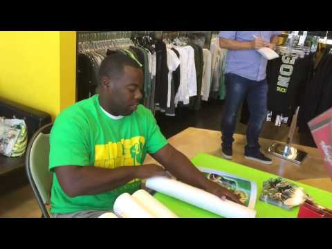 Oregon football legend Kenny Wheaton signs autographs at the Duck Store