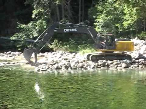 Backhoe building the swimming hole dam at Trinity Alps Resort