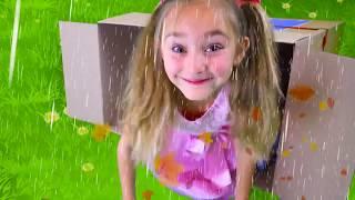 Sasha and Papa hiding from the rain in playhouses